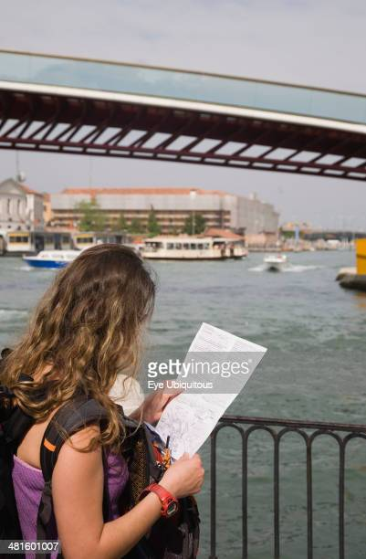 Italy Veneto Venice tourist looking at map near Ponte di Calatrava Bridge fourth bridge built across the Grand Canal linking the train station and...