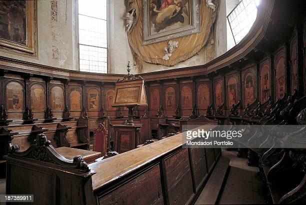 Italy Veneto Verona Chiesa di Santa Maria in Organo Detail The choir of the church with its many wooden inlays around the swivel bookstand carved and...