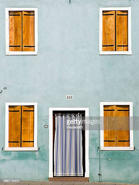 Italy, Venice, Burano, House facade, closed shutters, Front door with curtain