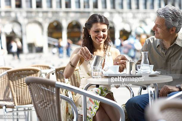 Italy, Venice, couple at cafe table, outdoors