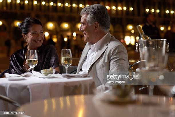 """Italy, Venice, couple at restaurant table at night, outdoors"""