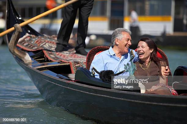 Italy, Venice, couple riding in godola, laughing