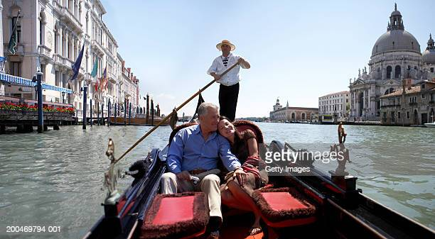"""italy, venice, couple riding in godola, woman leaning against man"" - venezia foto e immagini stock"