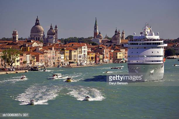 Italy, Venice, cruise ship and tour boats on canal
