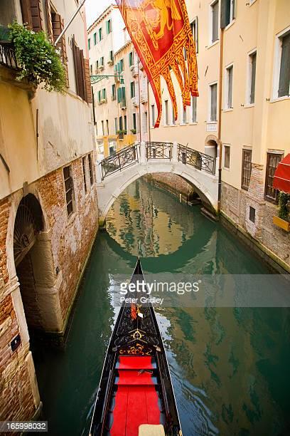 Italy, Venice, gondola in  canal, Venetian flag