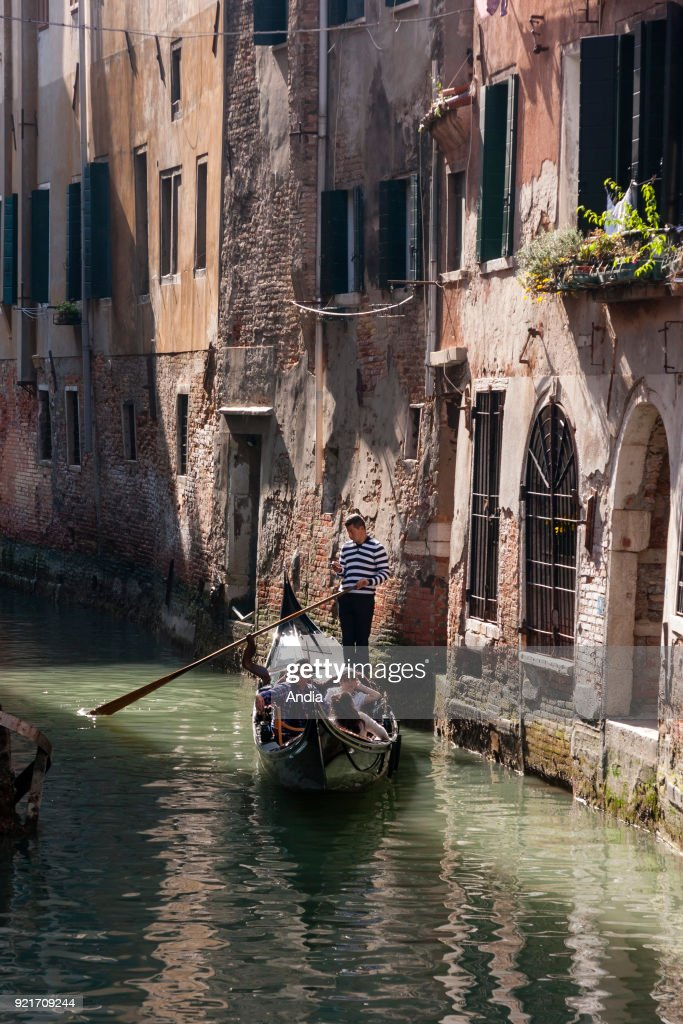 Gondolier in the district of St. Mark. : News Photo