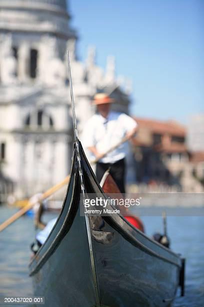 Italy, Venice, gondolier steering gondola (focus on gondola)