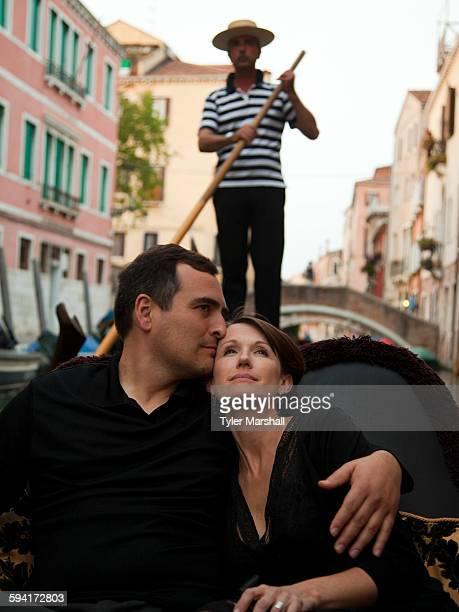 Italy, Venice, Mature couple embracing in gondola