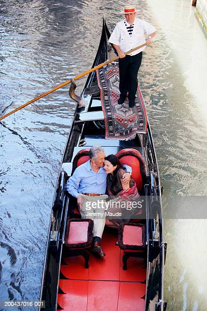 Italy, Venice, mature couple in gondola, overhead view