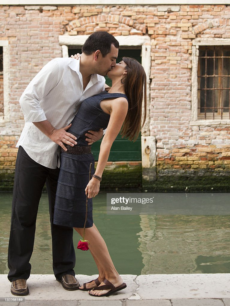 italy venice mature couple kissing on bridge stock photo | getty images