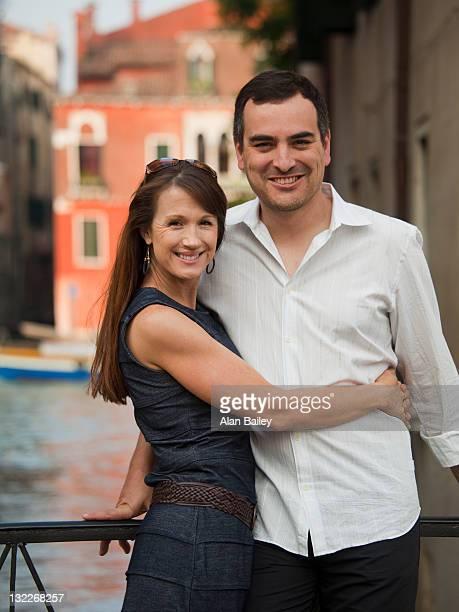 Italy, Venice, Mature couple posing on bridge