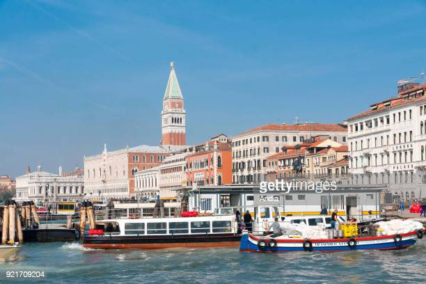 vaporetto water bus stop along the Riva degli Schiavoni In the background the Doge's Palace and Piazza San Marco