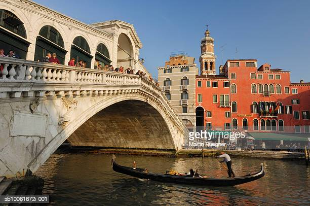 Italy, Venice. View of a canal with Rialto bridge