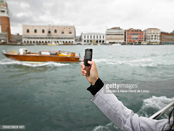 italy, venice, woman photographing with mobile phone, close-up of arm - vaporetto stock pictures, royalty-free photos & images
