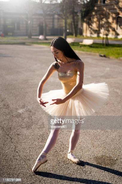 Italy, Verona, Ballerina dancing in the city