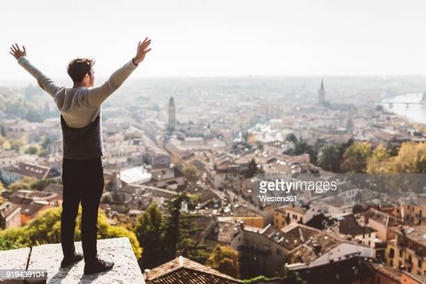 Italy, Verona, tourist standing at obversation point