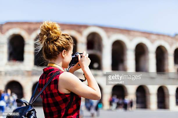 Italy, Verona, woman taking picture of Verona Arena