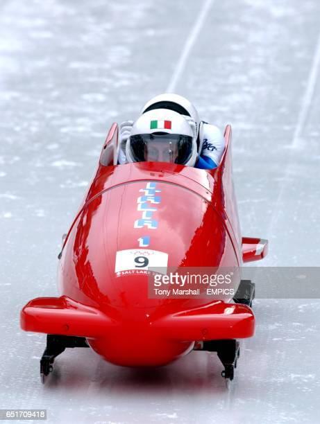 Italy's 1 brakewoman Antonella Bellutti and pilot Gerda Weissensteiner at the start of the run