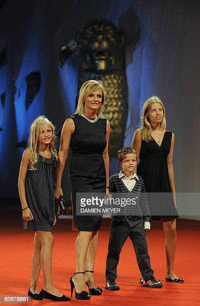 Italy's actress Isabella Ferrari and her children Nina Giovanni and Teresa pose before the screening of the movie Il Seme della Discordia directed by...