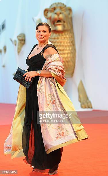 Italy's actress Serena Grandi poses before the screening of the movie Il Papa Di Giovanna during the 65th Venice International Film Festival at...