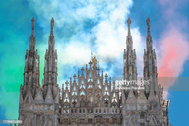 Italy's aerobatic team Frecce Tricolori fly over Milan in Duomo Square as part of celebrations for the 74th anniversary of the proclamation of the...