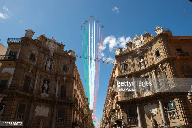 Italy's aerobatic team Frecce Tricolori fly over Palermo over Quattro Canti place as part of celebrations for the 74th anniversary of the...