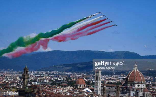Italyâs aerobatic team Frecce Tricolori fly over the city of Florence as part of celebrations for the 74th anniversary of the proclamation of the...