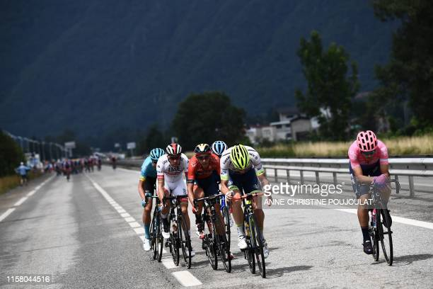 Italy's Alberto Bettiol Belgium's Kevin Van Melsen Belgium's Dylan Teuns and Portugal's Rui Costa ride in a breakaway on the highway during the...