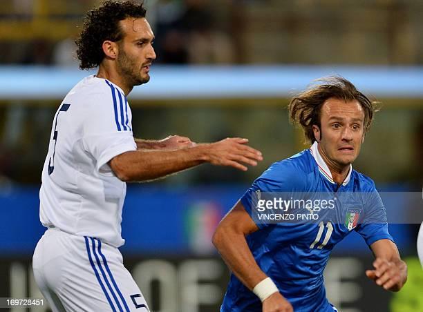 Italy's Alberto Gilardino vies with Alessandro Della Valle of San Marino during their friendly football match at Dall'Ara stadium in Bologna on May...