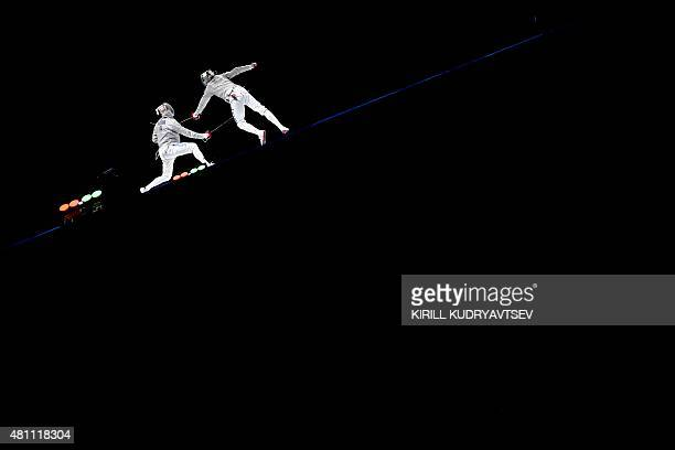 Italy's Aldo Montano and Russia's Alexey Yakimenko compete in the men's sabre team gold match at the 2015 World Fencing Championships in Moscow on...