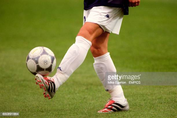 Italy's Alessandro Del Piero wearing silver Adidas Predator boots shows off his ball skills before the match