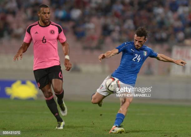 Italy's Alessandro Florenzi kicks the ball next to Scotland's Matty Philips during the International friendly football match Italy vs Scotland at the...