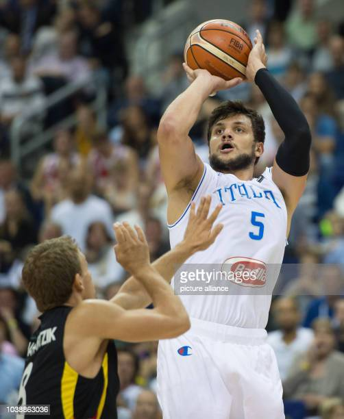 Italy's Alessandro Gentile and Germany's Heiko Schaffartzik in action during the FIBA EuroBasket 2015 Group B match Italy vs Germany in Berlin...
