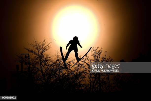 TOPSHOT Italy's Alessandro Pittin flies through the sun disk during the nordic combined men's individual Gundersen LH/10km official training 3 at the...