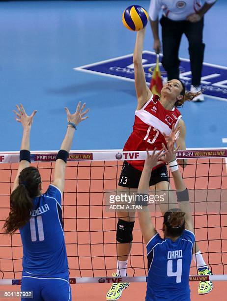 Italy's Alessia Orro and Cristina Chirichella vies with Turkey's Guldeniz Onalduring the Women's European Olympic Qualification volleyball match...