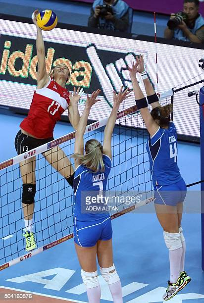 Italy's Alessia Orro and Martina Guiggi vie with Turkey's Neriman Ozsoy during the Women's European Olympic Qualification volleyball match between...