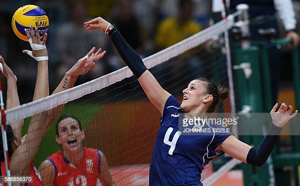 Italy's Alessia Orro spikes the ball during the women's qualifying volleyball match between Serbia and Italy at the Maracanazinho stadium in Rio de...