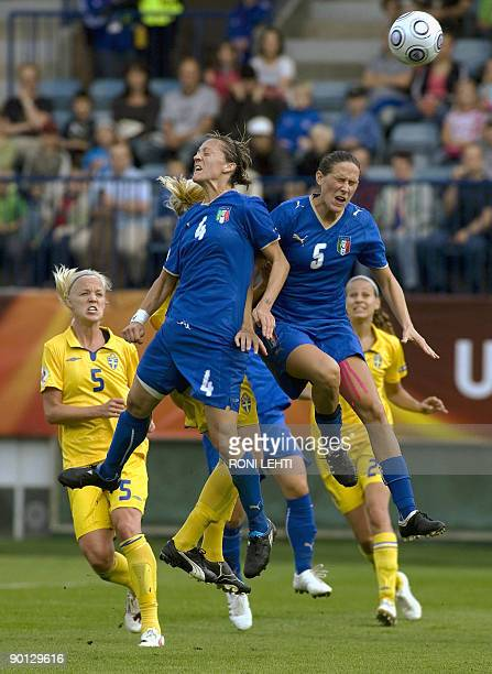 Italy's Alessia Tuttino and Elisabetta Tona jump for the ball as Sweden's Caroline Seger looks on during the UEFA women's Euro 2009 group C football...