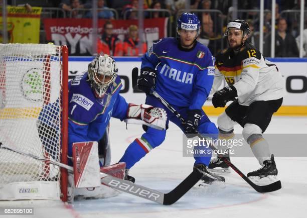 Italy´s Alexander Egger and Andreas Bernard vie with Germany´s Brooks Macek during the IIHF Men's World Championship ice hockey match between Italy...