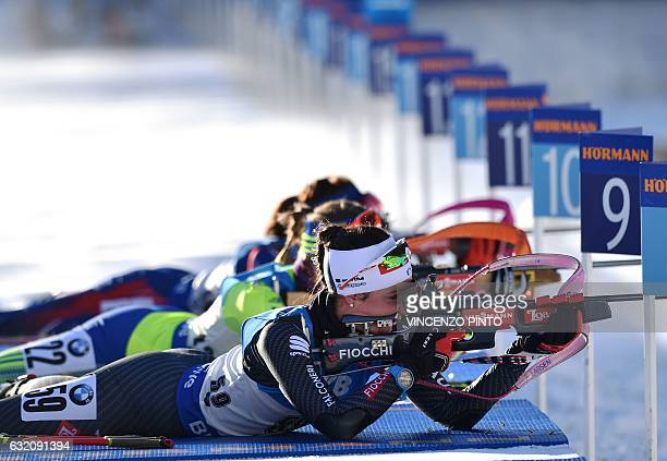 Italy's Alexia Runggaldier aims to shoot during the Biathlon World Cup Women's 15km individual race in Anterselva on January 19 2017 Laura Dahlmeier...