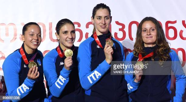 Italy's Alice Volpi Arianna Errigo Martina Batini and Camilla Mancini pose with their gold medals after defeating the Russian team in the women's...