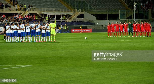 Italy's and Malta's teams observe one minute of silence to pay homage to the deceased of Europe's migrant crisis during the UEFA Euro 2016 group H...