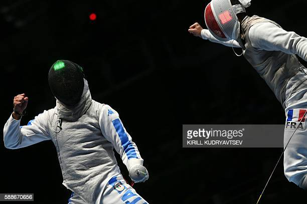 Italy's Andrea Baldini and France's Erwan le Pechoux react during the mens team foil semifinal bout between Italy and France as part of the fencing...