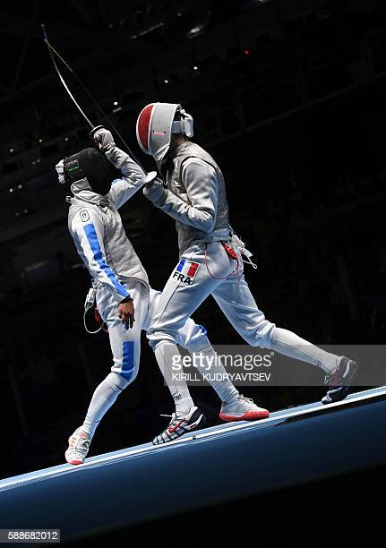 Italy's Andrea Baldini competes against France's Jeremy Cadot during the mens team foil semifinal bout between Italy and France as part of the...