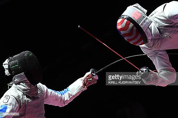 Italy's Andrea Baldini competes against US Miles ChamleyWatson during the mens team foil bronze medal bout between Italy and US as part of the...