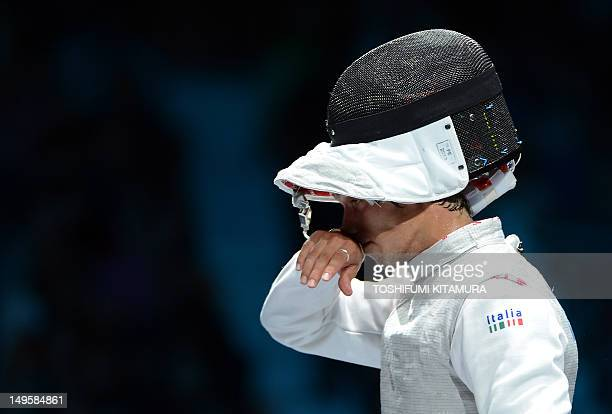 Italy's Andrea Baldini reacts at the end of his Men's foil bronze medal bout against South Korea's Choi Byungchul as part of the fencing event of...