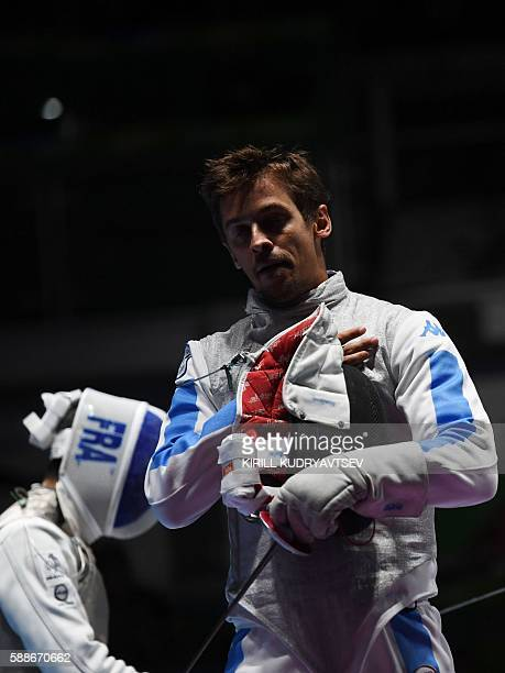Italy's Andrea Baldini reacts during the mens team foil semifinal bout between Italy and France as part of the fencing event of the Rio 2016 Olympic...