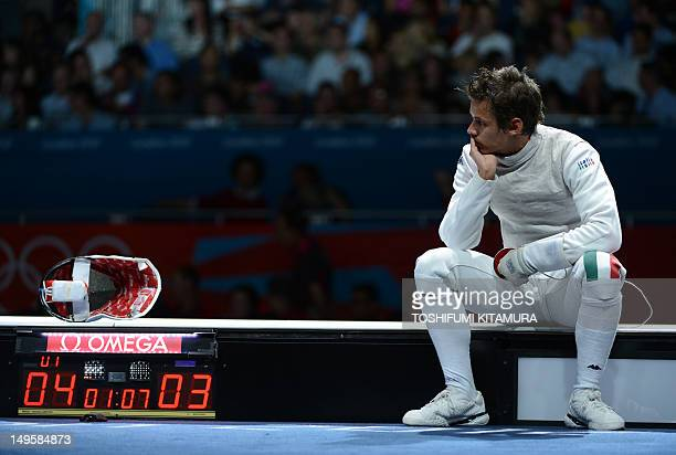 Italy's Andrea Baldini waits during an interruption of his Men's foil bronze medal bout against South Korea's Choi Byungchul as part of the fencing...