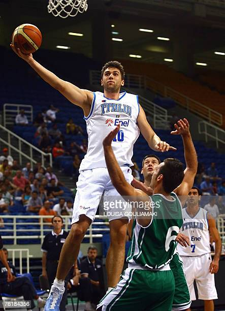 Italy's Andrea Bargnani tries to score past Alexander Capin of Slovenia during their basketball match for the International Basketball tournament...