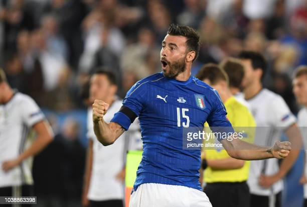 Italy's Andrea Barzagli cheers during penalty shootout during the UEFA EURO 2016 quarter final soccer match between Germany and Italy at the Stade de...